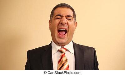 Tired businessman yawning