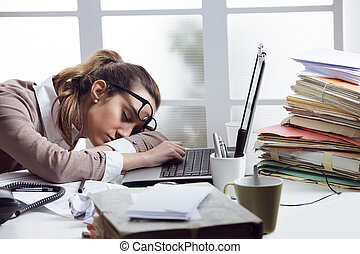 Tired businesswoman sleeping on the desk, in front of the...