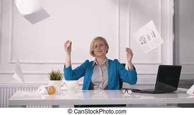 Tired Businesswoman Throws Paper - Tired businesswoman...