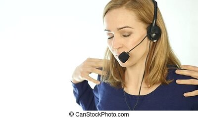 tired call center representative talking on helpline, Headset telemarketing female call center agent at work. slow motion
