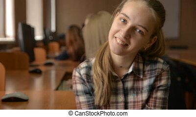 Tired cheerful young blonde. Female student in a computer...