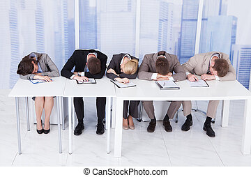 Tired Corporate Personnel Officers At Table - Group of tired...