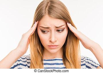Tired cute girl suffering from headache