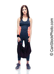 Tired cute woman standing with sports bag - Full length...