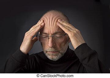 tired elder man with glasses