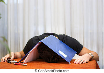 Tired, exhausted or despondent young man with a folder over his head