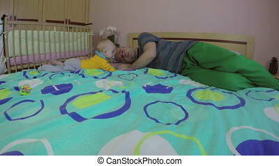 Tired father man sleeping and cute newborn baby boy. 4K