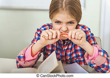 Tired girl in light classroom