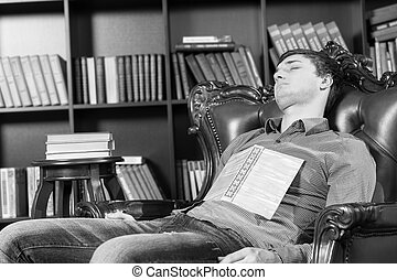 Tired Guy Resting on Chair with Book on his Chest