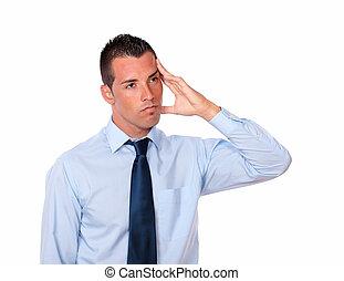 Tired hispanic man with head pain