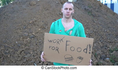 Tired hobo man on the street. Sign on cardboard - will work...
