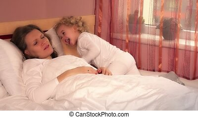Tired loving mother woman cant sleep because of her...