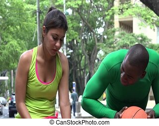 Tired Male And Female Athletes On Hot Day
