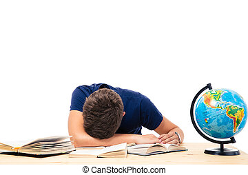 Tired male student sleeping on the table