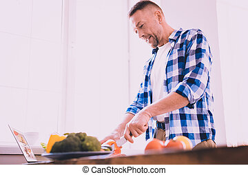 Tired man cooking lunch for family and guests