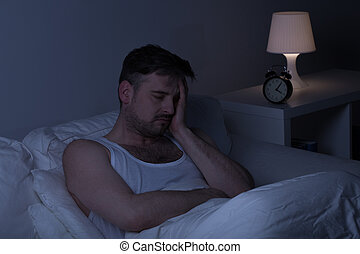 Tired man needs some sleep