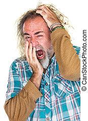 Tired Man Scratching Head - European man in beard yawning...