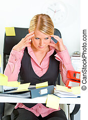 Tired modern business woman sitting at workplace overwhelmed...
