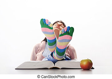 Tired of studies,  student relaxing  with his feet up on his desk, similar pictures on my portfolio