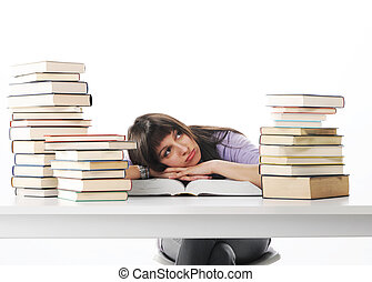 Tired of studies, young Woman on her desk with books, similar pictures on my portfolio