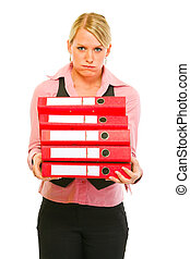 Tired of work modern female manager with pile of folders