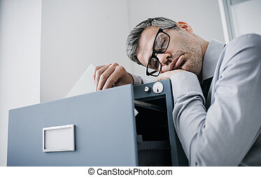 Tired office worker sleeping in the office