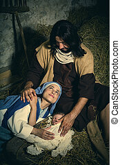 Tired parents in christmas nativity scene