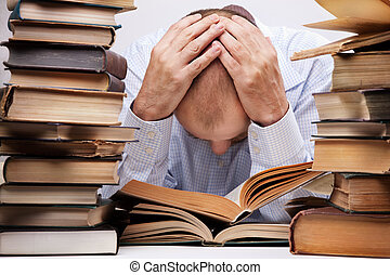 tired reader - overworked man with many books, focus point...