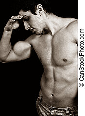 Tired sad weary male bodybuilder