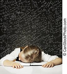 Tired Schoolgirl on the Blackboard Background