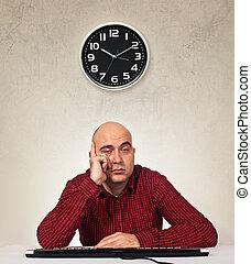 Tired sleepy man with computer keybaord