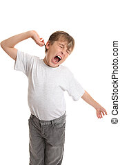 Tired, Stretch, Yawning - A tired boy stretches his arms and...