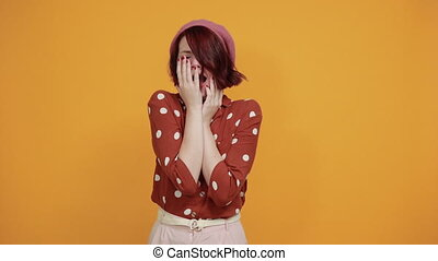 Tired tiny beauty woman looks bored, covering half face, eye and mouth with hand
