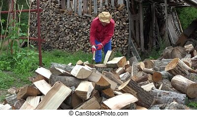 Tired villager guy chopping wood refresh with water bottle. 4K