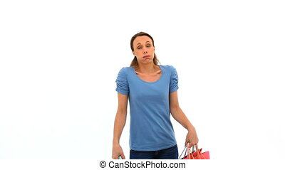 Tired woman holding shopping bags