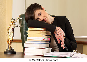 tired woman lawyer in the office with books and documents
