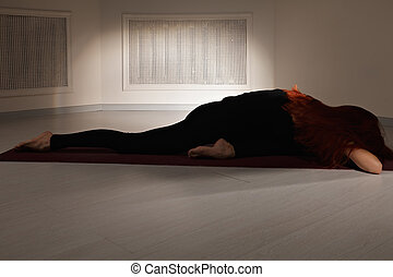 Tired woman on a red mat