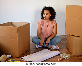 Tired woman preparing for home relocation