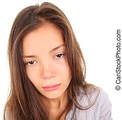 Tired woman with empty and bored eyes. Mixed race asian / ...