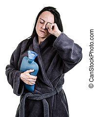Tired, woman with hot water bottle