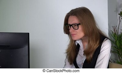 tired woman work at office computer desk. Female officer at project deadline