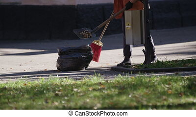 Tired woman working hard as street cleaner, low paid manual labor, poverty