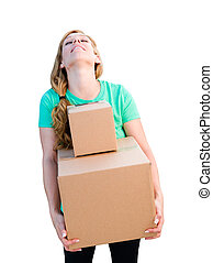 Tired Young Adult Woman Holding Moving Boxes Isolated On A White Background.
