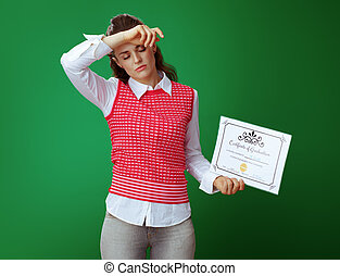 tired young student woman with Certificate of Graduation