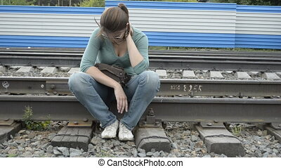 Tired young woman sitting