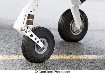 Tires of a small propeller airplane