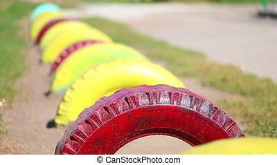 tires on the playground sun summer sport