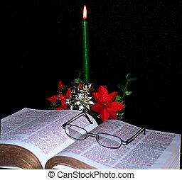 Candle gently lighting a Bible