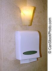 tissue box on the wall at washroom