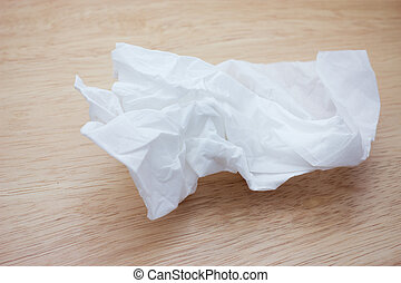 Crumpled two ply tissue paper on wood background